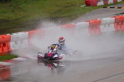 Ethan Ho tackles a large puddle