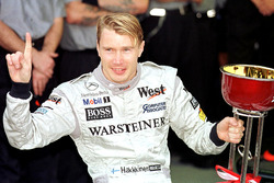 Mika Hakkinen, McLaren celebrates winning the Formula One World Championship