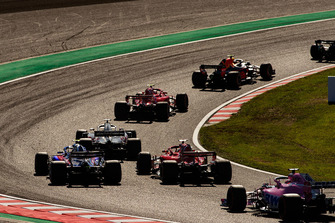 Max Verstappen, Red Bull Racing RB14, leads Kimi Raikkonen, Ferrari SF71H, Romain Grosjean, Haas F1 Team VF-18, Sebastian Vettel, Ferrari SF71H, Pierre Gasly, Scuderia Toro Rosso STR13, and Brendon Hartley, Toro Rosso STR13, at the start