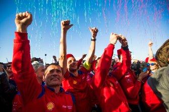 Mahindra Racing team members celebrate