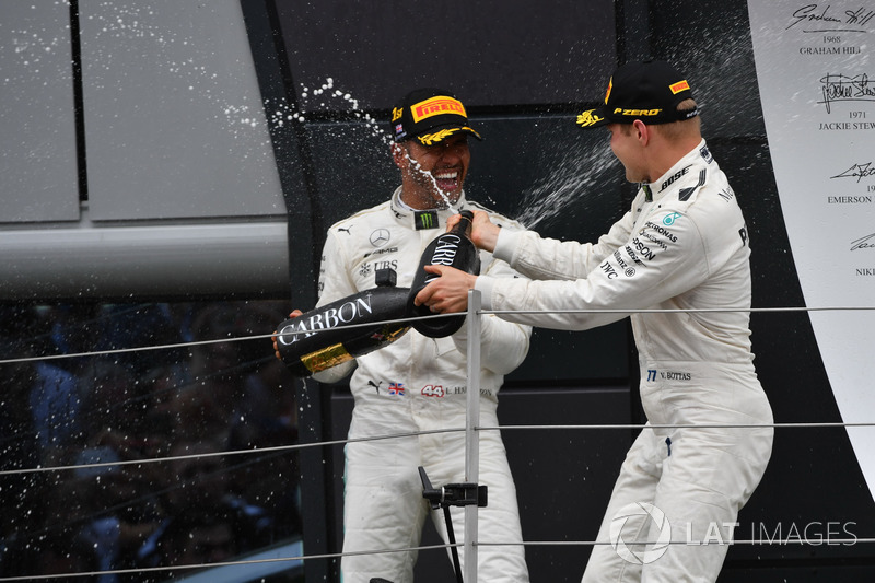 Race winner Lewis Hamilton, Mercedes AMG F1 and Valtteri Bottas, Mercedes AMG F1 celebrate on the podium, the champagne