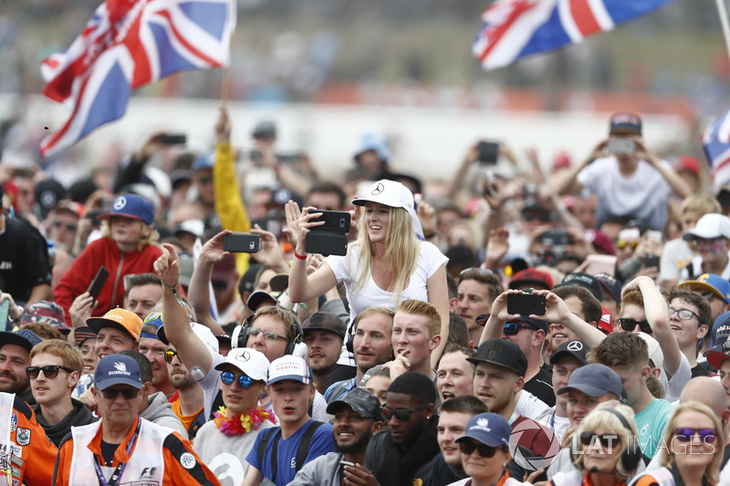 Fans cheer for Race winner Lewis Hamilton, Mercedes AMG F1, on the podium