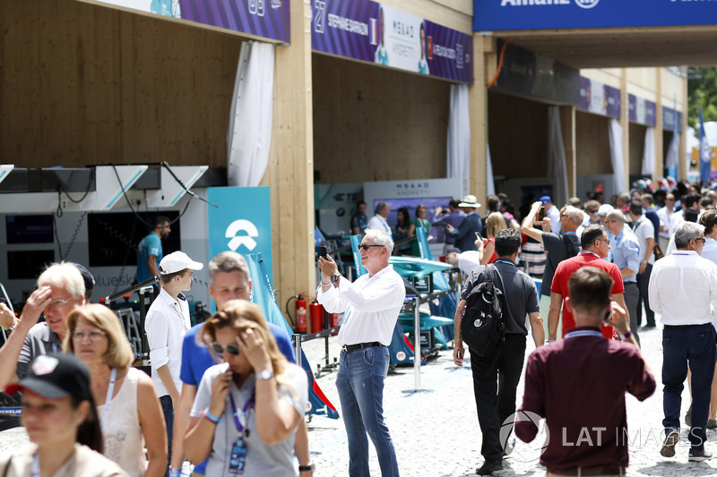 Fans walk in the pit lane