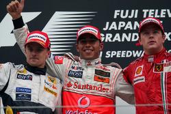 Heikki Kovalainen, Renault, Lewis Hamilton, McLaren and Kimi Raikkonen, Ferrari on the podium