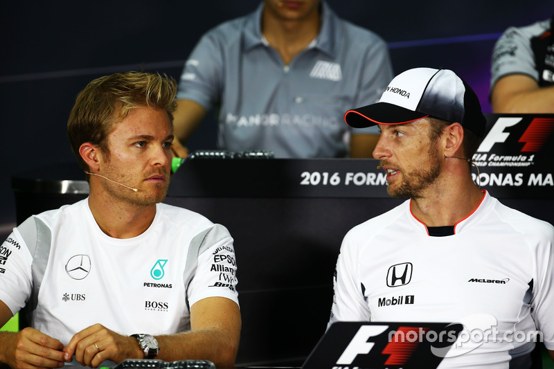 (L to R): Nico Rosberg, Mercedes AMG F1 with Jenson Button, McLaren in the FIA Press Conference