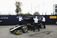 The new F2 car is unveiled in the paddock