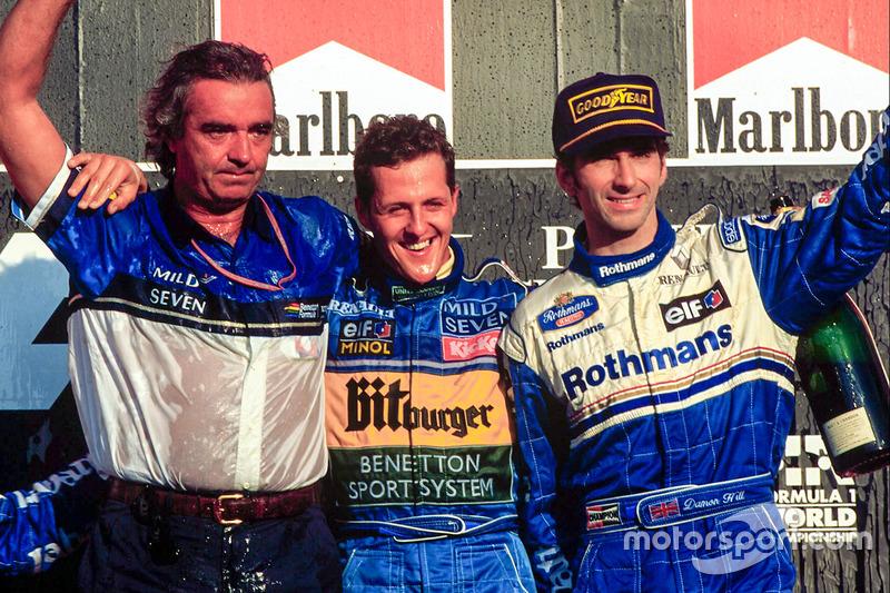 Podium: race winner and World Champion Michael Schumacher, Benetton celebrates with Flavio Briatore and third place Damon Hill