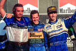 Podium: race winner and World Champion Michael Schumacher, Benetton celebrates with Flavio Briatore and third place Damon Hill
