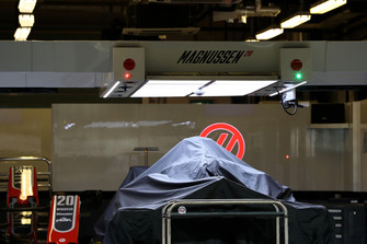 Haas VF-18 under covers in the garage
