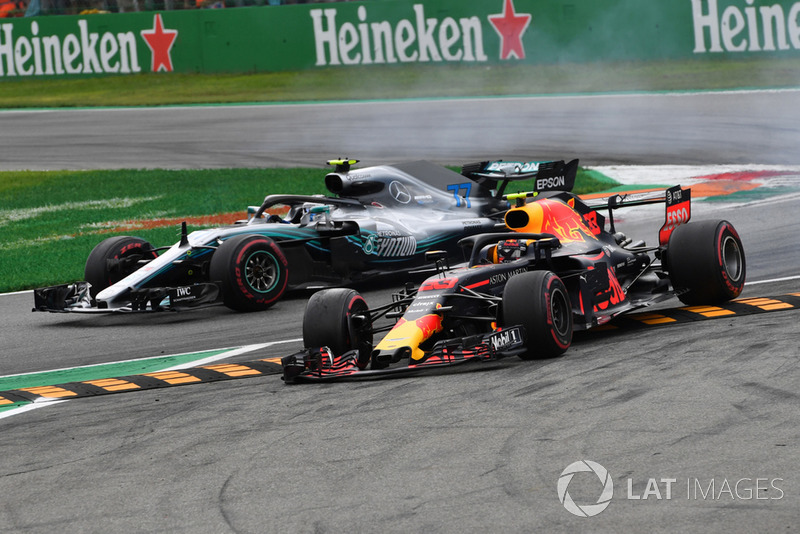 Verstappen runs over chicane while battling Bottas