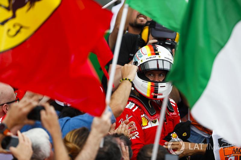 Sebastian Vettel, Ferrari, merayakan kemenangan
