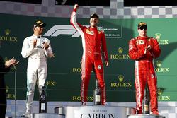 Sebastian Vettel, Ferrari, celebrates victory on the podium with second place Lewis Hamilton, Mercedes AMG F1, and third place Kimi Raikkonen, Ferrari