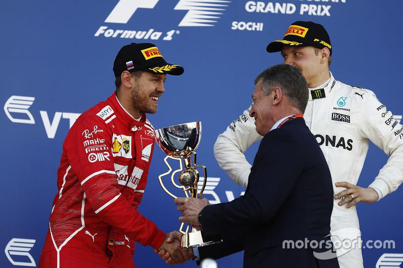 Sebastian Vettel, Ferrari, receives his second place trophy from Russian Prime Minister Medvedev