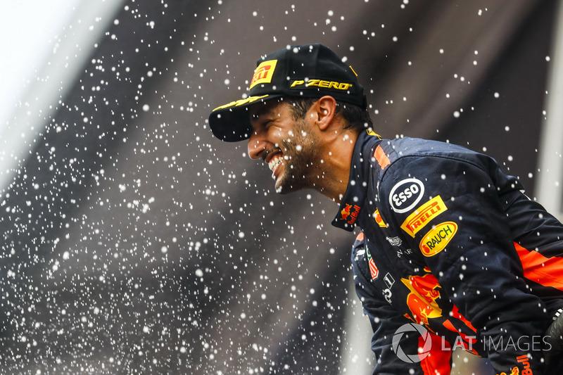 Third place Daniel Ricciardo, Red Bull Racing, sprays Champagne on the podium