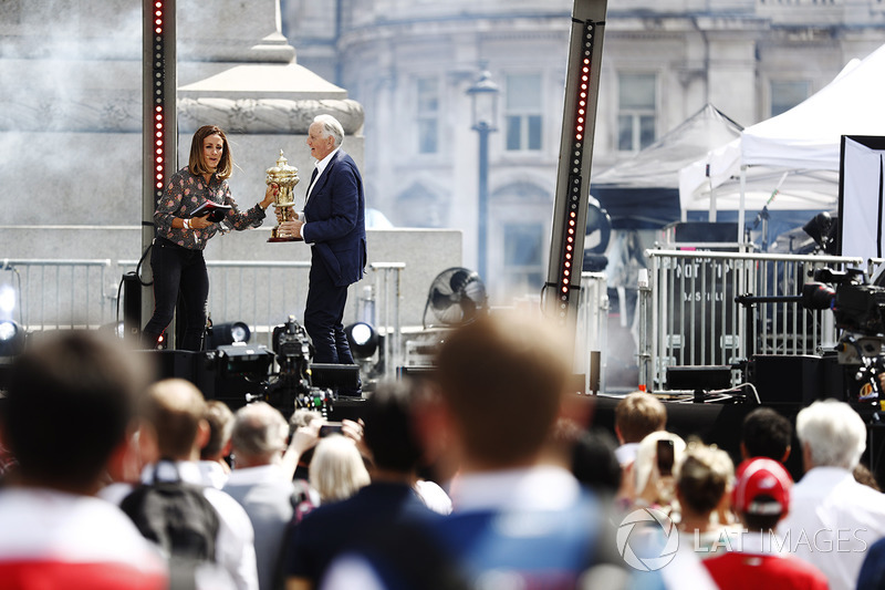Natalie Pinkham, TV Presenter, Sky F1, former racer John Watson, the British Grand Prix Trophy on stage
