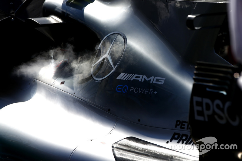 Steam emerges from the Mercedes AMG F1 W08 on the grid