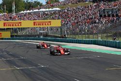 Pole sitter Sebastian Vettel, Ferrari SF70-H and Kimi Raikkonen, Ferrari SF70-H