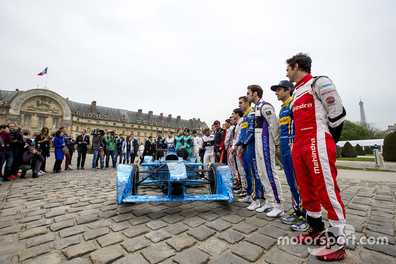 Drivers pose with the iceberg livery on a Formula E car that will be auctioned off to raise money to fight climate change