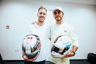 Lewis Hamilton, Mercedes AMG F1, and Sebastian Vettel, Ferrari, swap F1 helmets