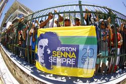 Fans with an Aryton Senna flag