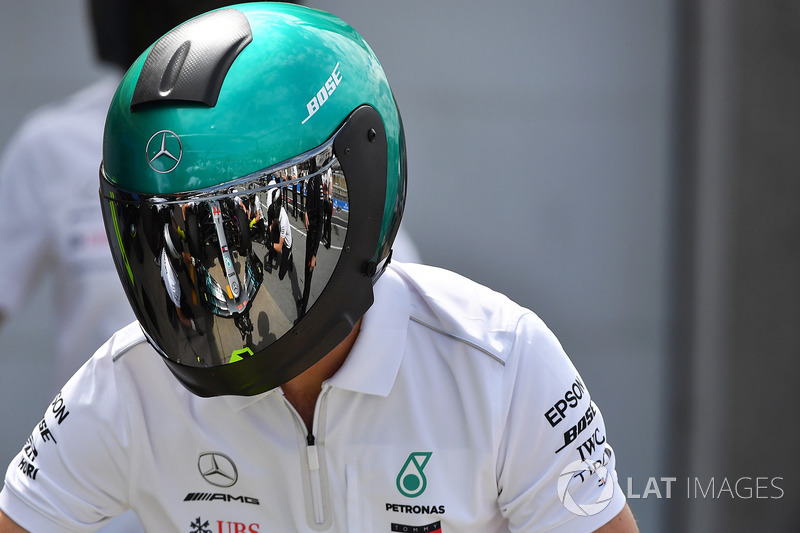 Mercedes AMG F1 mechanic with reflection in helmet