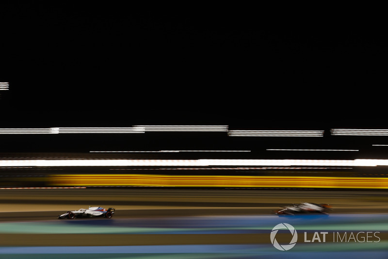 Sergey Sirotkin, Williams FW41 Mercedes, leads Romain Grosjean, Haas F1 Team VF-18 Ferrari