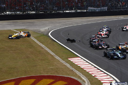Rubens Barrichello, Honda RA107, leads Giancarlo Fisichella, Renault R27, Sebastian Vettel, Toro Rosso STR02, Vitantonio Liuzzi, Toro Rosso STR02,  Ralf Schumacher, Toyota TF107, and the rest of the field as Heikki Kovalainen, Renault R27, runs off the circuit after contact