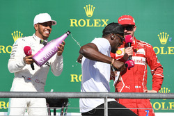 Race winner Lewis Hamilton, Mercedes AMG F1 celebrates on the podium with the champagne and Usain Bolt, third place Kimi Raikkonen, Ferrari