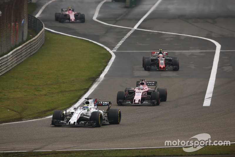 Felipe Massa, Williams FW40, leads Sergio Perez, Force India VJM10, Kevin Magnussen, Haas F1 Team VF-17 and Esteban Ocon, Force India VJM10 out of the pit lane