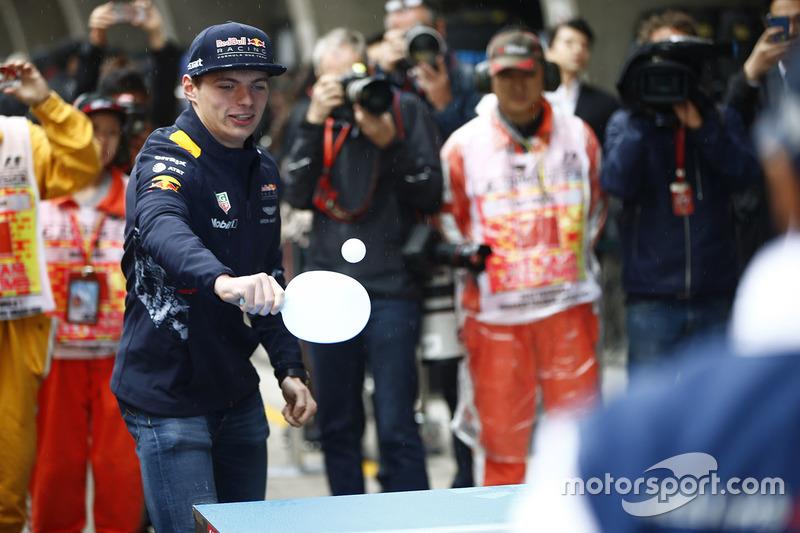 Max Verstappen, Red Bull Racing, and Felipe Massa, Williams, play table tennis