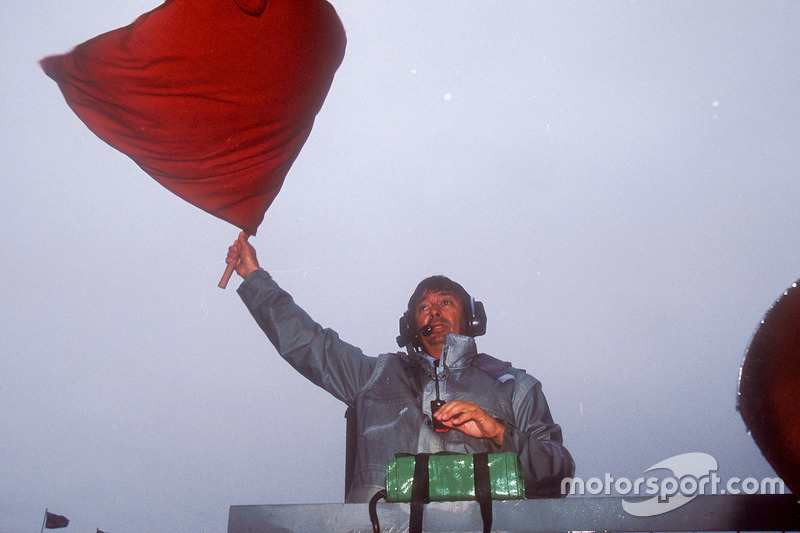 FIA Race Starter Roland Bruynseraede waves the red flag to stop the race after 15 laps, due to the t