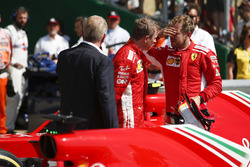 Kimi Raikkonen, Ferrari, talks to Race winner Sebastian Vettel, Ferrari, in Parc Ferme