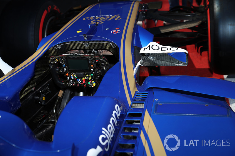 The steering wheel and cockpit detail of Sauber C36