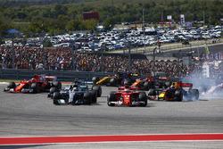 Sebastian Vettel, Ferrari SF70H, passes Lewis Hamilton, Mercedes AMG F1 W08, at the start