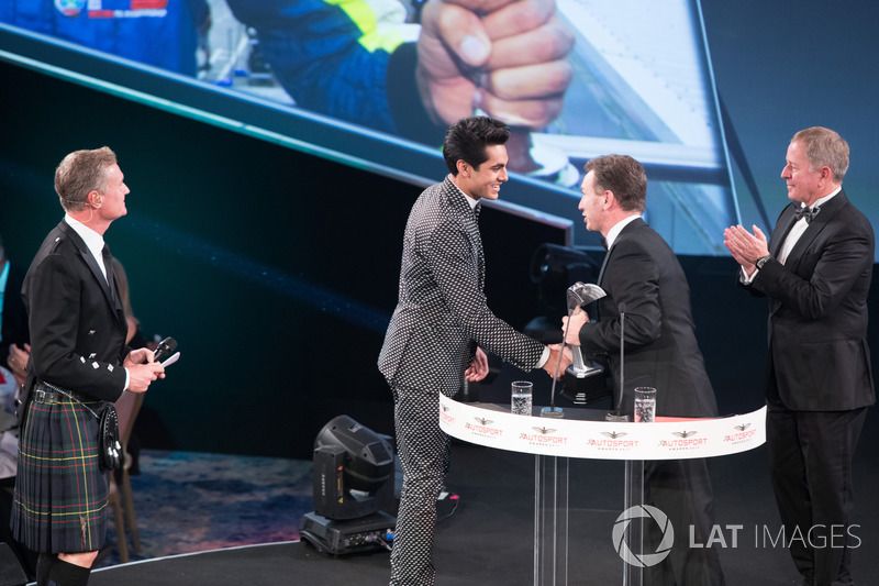 Enaam Ahmed on stage with Christian Horner and Martin Brundle to accept the British Club Driver of the Year Award