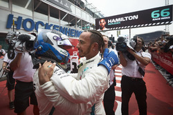 Valtteri Bottas, Mercedes AMG F1, and Race winner Lewis Hamilton, Mercedes AMG F1, celebrate in Parc Ferme