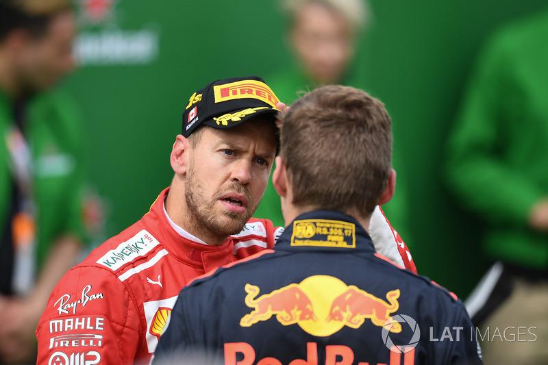 Sebastian Vettel, Ferrari y Max Verstappen, Red Bull Racing