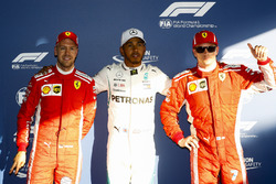 Lewis Hamilton, Mercedes AMG F1, celebrates taking pole position between Kimi Raikkonen, Ferrari, an