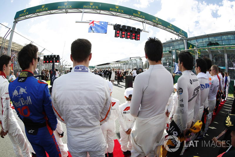 Drivers stand for the Australian national anthem. L-R: Charles Leclerc, Sauber, Pierre Gasly, Toro R