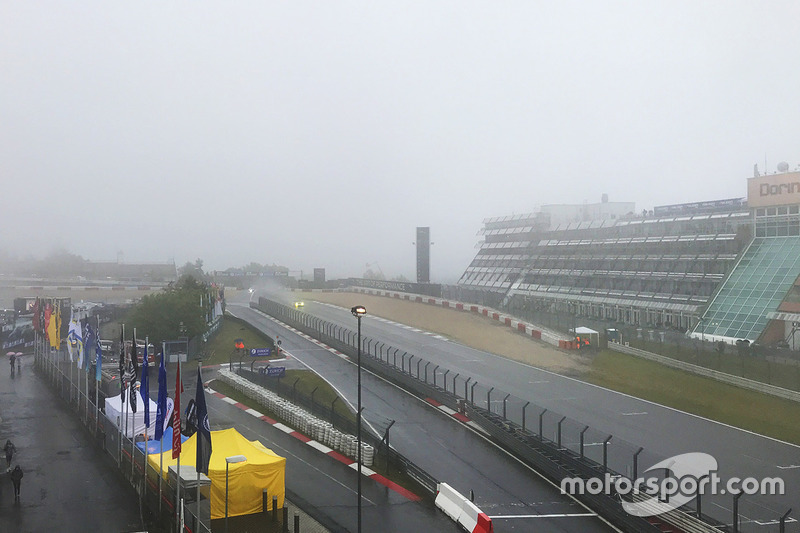 Fog covers the start/finish straight near the Dorint hotel