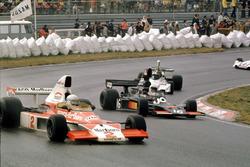 Jochen Mass,McLaren M23 Ford leads Tom Pryce, Shadow DN5A Ford