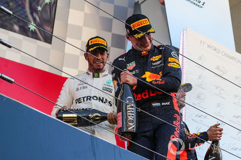Lewis Hamilton, Mercedes AMG F1 and Max Verstappen, Red Bull Racing celebrate on the podium with the champagne