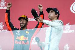 Lance Stroll, Williams celebrates on the podium, race winner Daniel Ricciardo, Red Bull Racing and does a Shoey