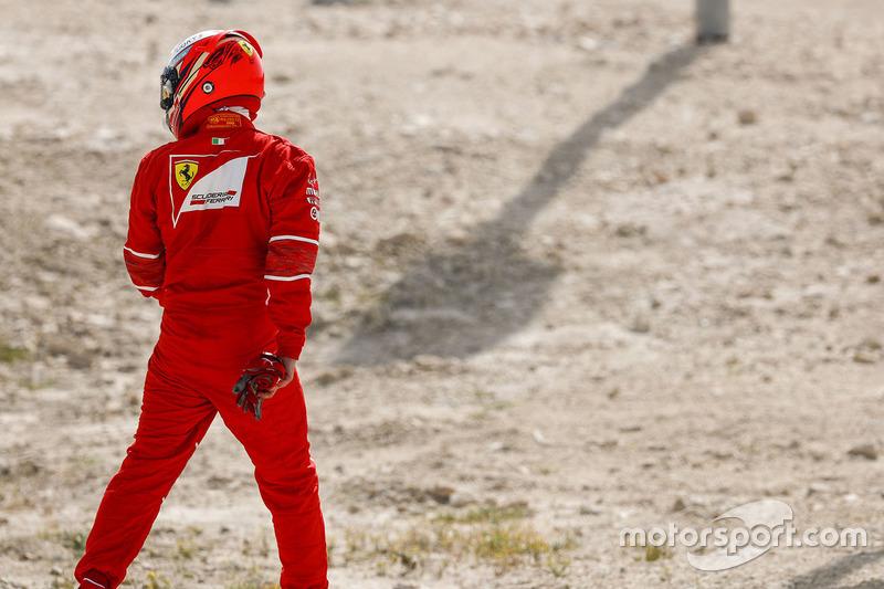 Kimi Raikkonen, Ferrari, heads back to the Ferrari garage