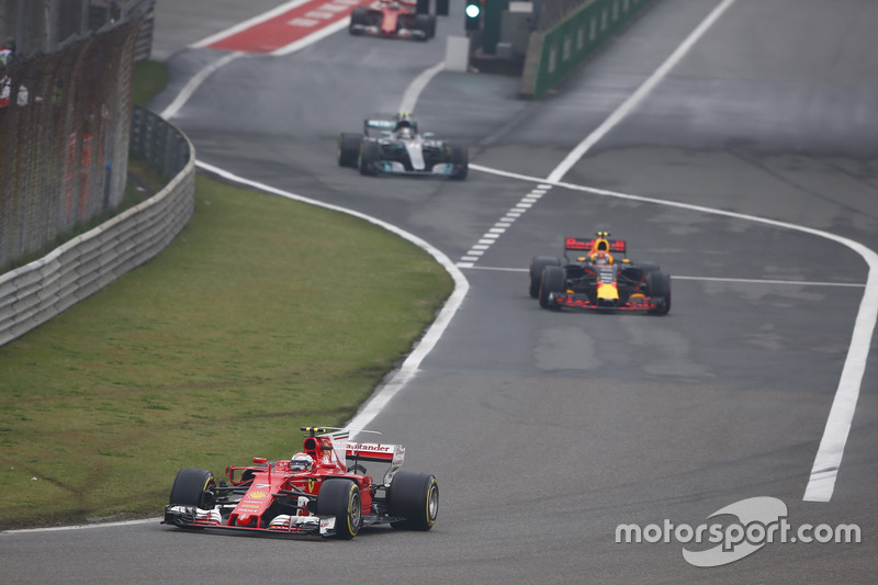 Kimi Raikkonen, Ferrari SF70H, leads Max Verstappen, Red Bull Racing RB13, and Valtteri Bottas, Mercedes AMG F1 W08, out of the pits