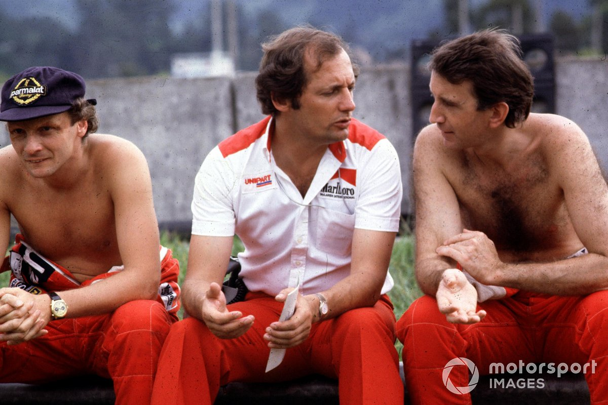Ron Dennis, McLaren-Ford Cosworth, with his drivers Niki Lauda and John Watson