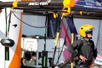A McLaren pit crew member stands by