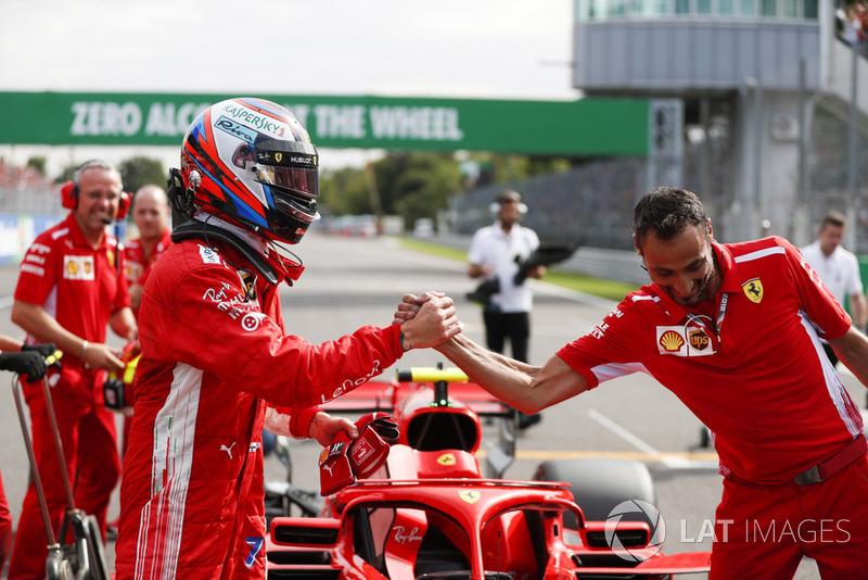 Polesitter Kimi Raikkonen, Ferrari celebrates