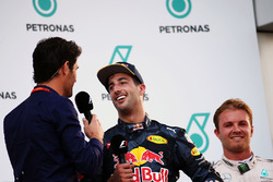 Race winner Daniel Ricciardo, Red Bull Racing on the podium with Mark Webber, Porsche Team WEC Driver / Channel 4 Presenter