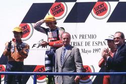 Podium: Race winner Valentino Rosst, Aprilia, second place Noboru Ueda, Honda, third place Jorge Martínez, Aprilia